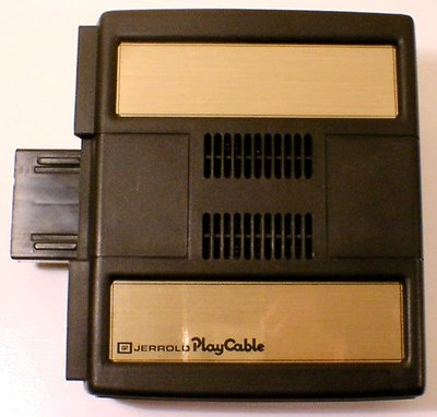 "Module Mattel ""PlayCable"" pour console Intellivision (1981)."